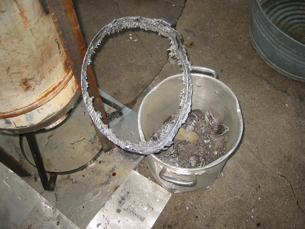 (11) Lead pipe often has a fair amount of antimony mixed into  the lead. The antimony will need more heat to melt and it will  cool form a ring at the top of the pot.