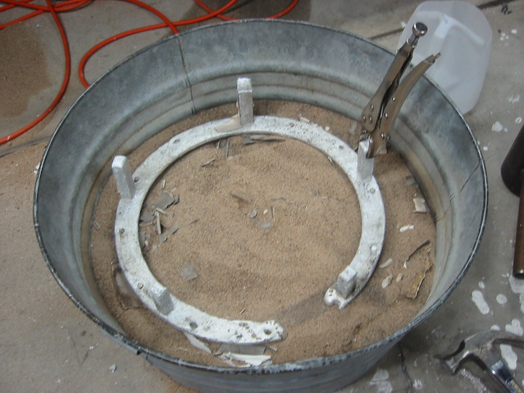 (1) A mud encased 14 inch foam ring with a spur 4 vent and the foam dissolved  failed to completely cast.