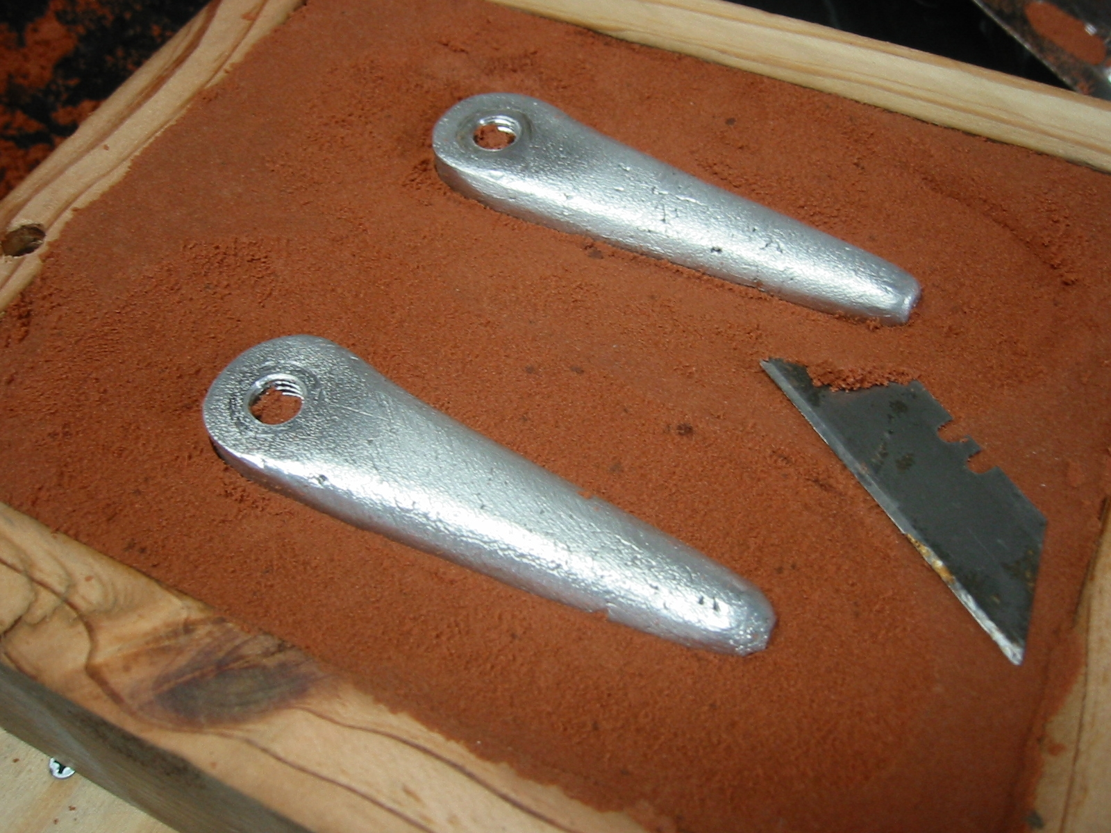 (5) Use a knife or blade to excavate the sand around the part/s just until you can safely lift the part from the sand without disturbing the remaining sand.  This will be your