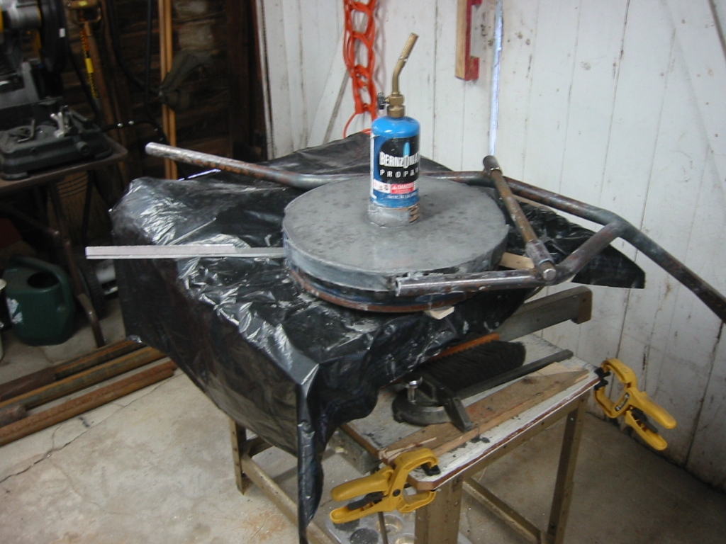 (3) Mizzou Castable Refractory poured in and vibrated by the table saw underneath.