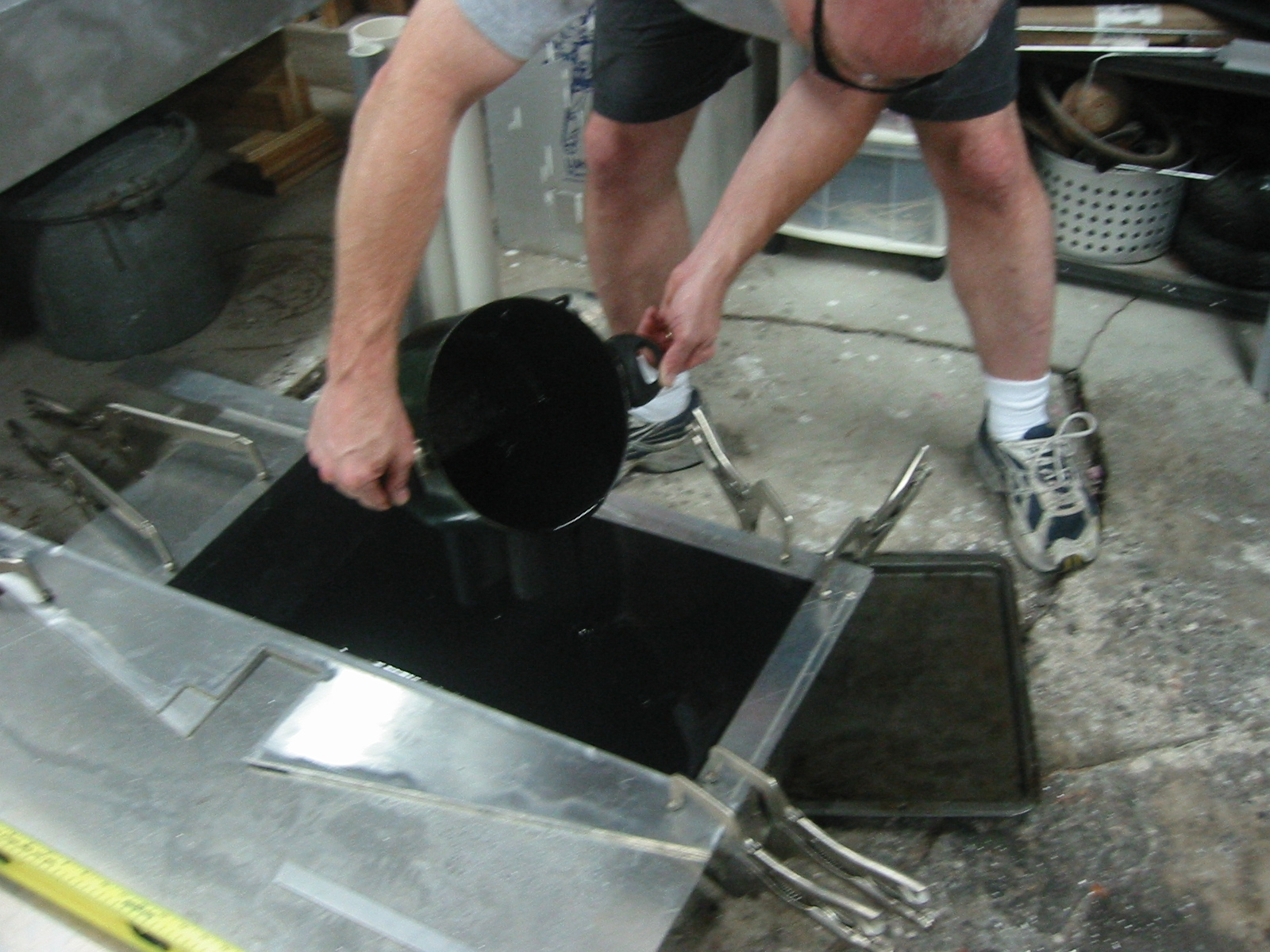 (2) Machineable wax being poured into the mold.