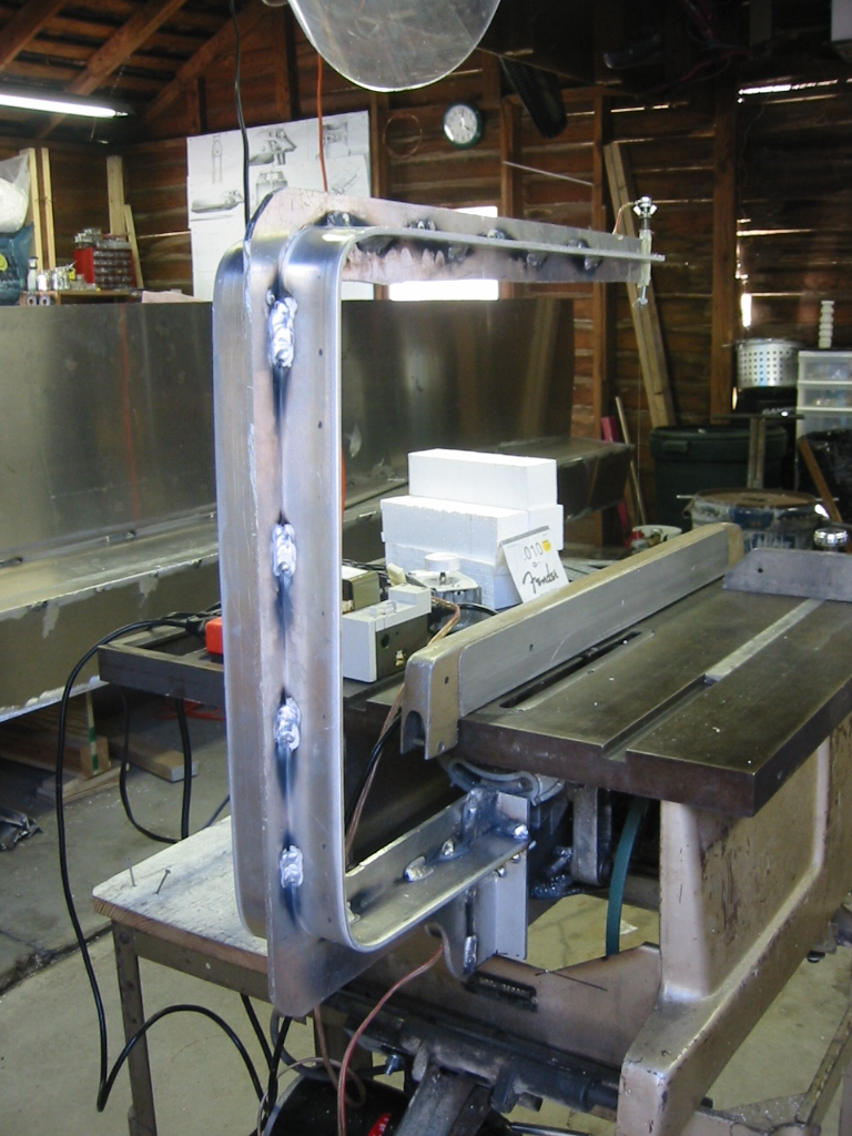 (2) Aluminum arm is bolted onto the back of the blade spindle  bracket.