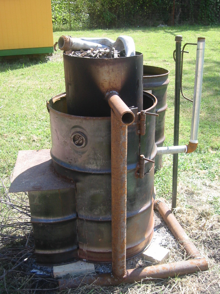 (1) Melting pot is suspended in a 55 gallon drum and a pipe  plumbed to the bottom can be  tilted to pour the lead off.